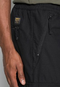 Carhartt WIP - JOGGER COLUMBIA - Cargo trousers - black rinsed - 4