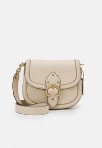 GLOVETANNED BEAT SADDLE BAG - Across body bag - ivory
