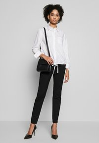Marc O'Polo - BLOUSE LONG SLEEVEED TIE DETAIL AT HEM POCKET - Button-down blouse - white - 1