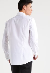 HUGO - ILIAS SLIM FIT - Formal shirt - open white - 2