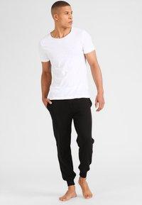 Calvin Klein Underwear - JOGGER - Pyjama bottoms - black - 1