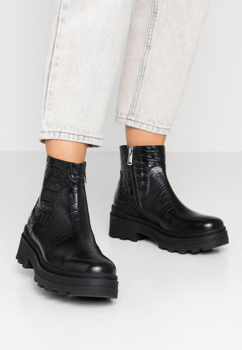 Janet Sport - Kotníkové boty na platformě - miranda nero