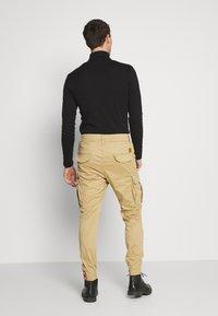 Alpha Industries - AIRMAN - Cargo trousers - sand - 2