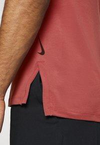 Nike Performance - TANK  - Sports shirt - claystone red/black - 6