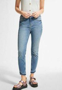 comma - Slim fit jeans - light-blue denim - 0