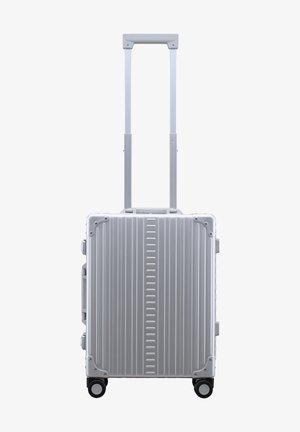 TRAVELER - Wheeled suitcase - platinum