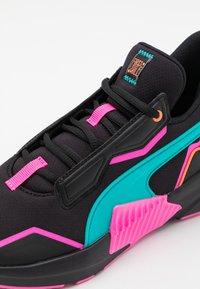 Puma - PROVOKE XT FM XTREME - Sports shoes - black/luminous pink/viridian green - 5