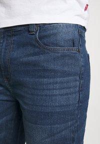 Newport Bay Sailing Club - Jeans straight leg - mid wash - 4