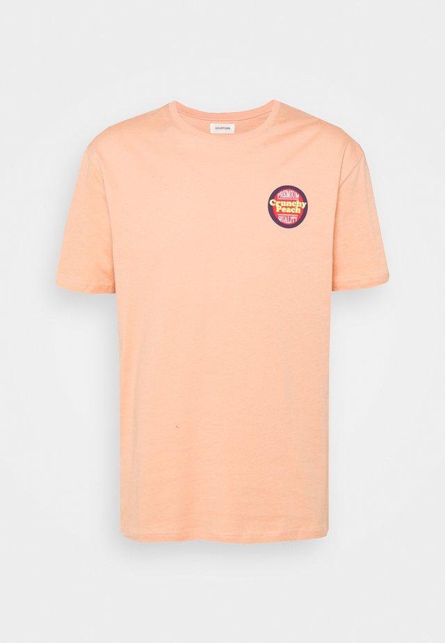UNISEX - T-shirt med print - beige