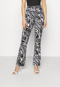 Juicy Couture - JOYPRINTED TROUSERS - Trousers - mono wave - 0
