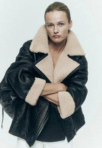 Massimo Dutti - BIKER LAMMFELL - Leather jacket - black - 1