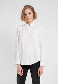 DKNY - FOUNDATION ROLL TAB THRU HIDDEN PLACKET - Button-down blouse - ivory - 0
