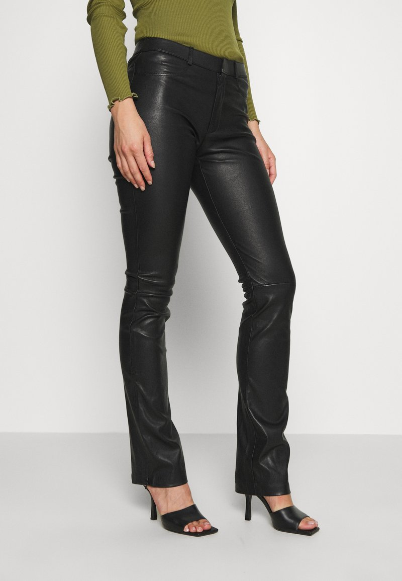 Ibana - LUCILLE - Leather trousers - black