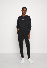 Calvin Klein Jeans - INSTITUTIONAL BACK LOGO - Sweatshirt - black - 1