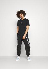 adidas Performance - 3-STRIPES O-PANT FUTURE ICONS - Tracksuit bottoms - black - 1