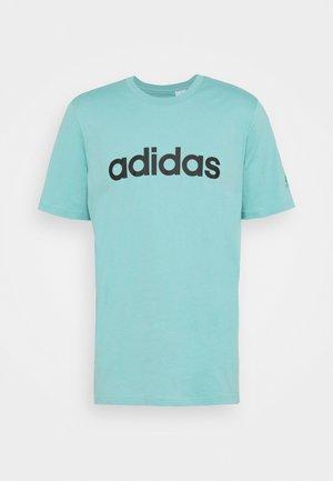 T-shirt z nadrukiem - mint ton/black