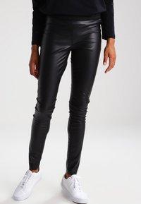 Vero Moda - Leggings - black - 0