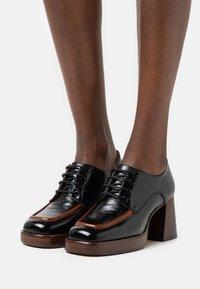 Jonak - BOPHA - Lace-up heels - brillant noir - 0