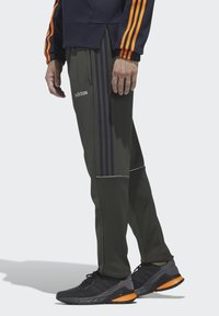 adidas Performance - INTUITIVE WARMTH SERENO JOGGERS - Tracksuit bottoms - green - 3