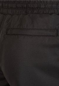 Puma - Tracksuit bottoms - black - 3