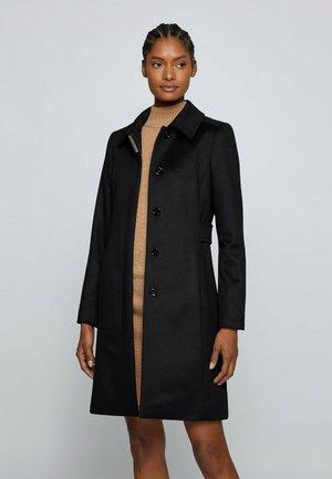 CASENA - Classic coat - black