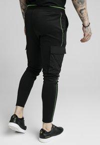 SIKSILK - ADAPT CRUSHED PANT - Cargo trousers - black - 2