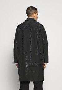 KARL LAGERFELD - UNISEX - Waterproof jacket - black - 2