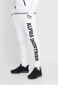 Alpha Industries - Tracksuit bottoms - white - 0