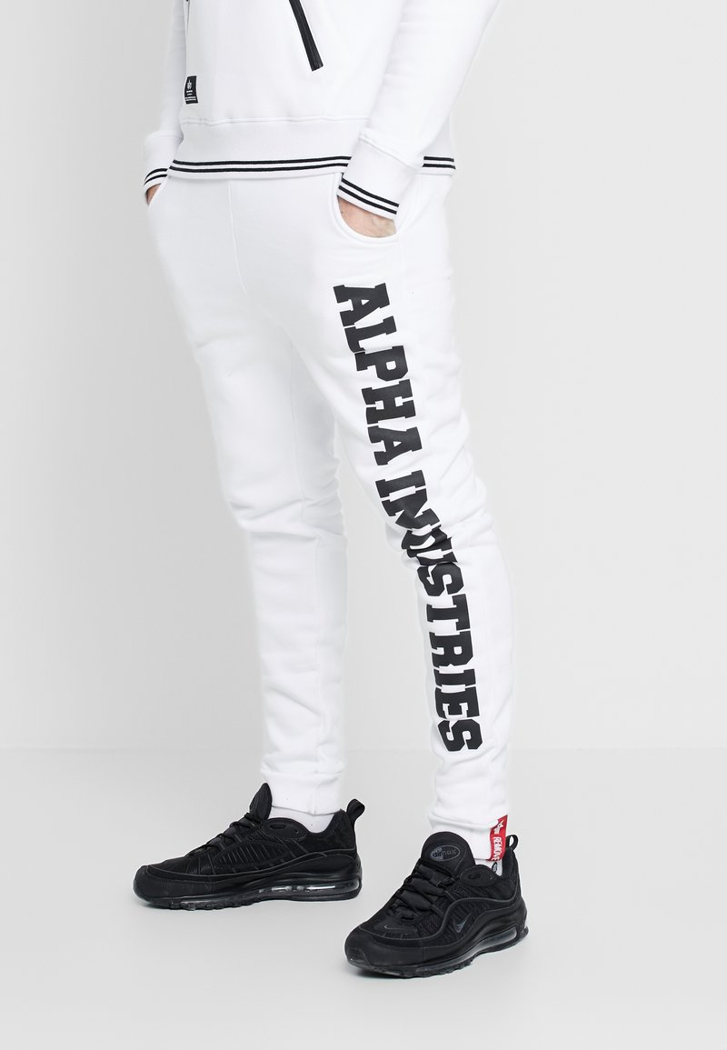 Alpha Industries - Tracksuit bottoms - white