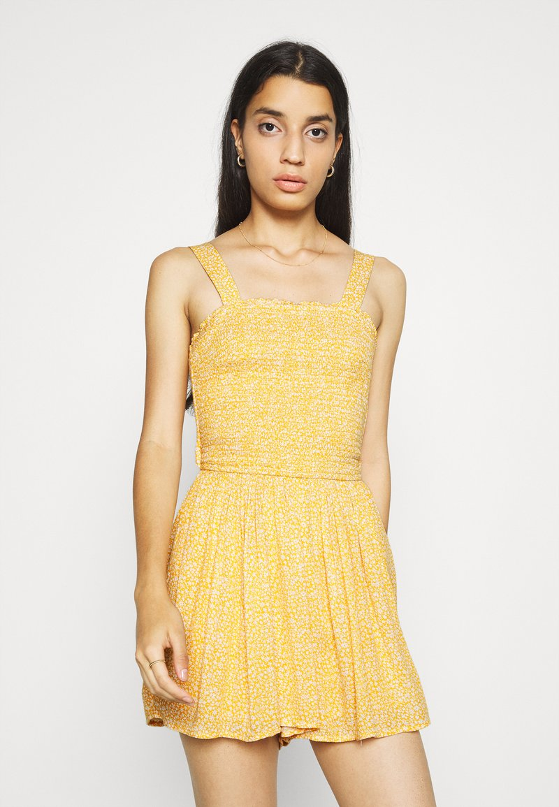 Hollister Co. - WEBEX BARE SMOCKED TIEBACK ROMPER - Overal - yellow