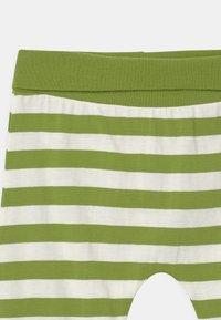 Sense Organics - SJORS BABY UNISEX - Trousers - green stripes - 3