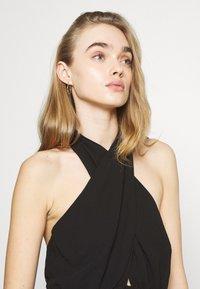 Gina Tricot - EXCLUSIVE MALVA HALTERNECK DRESS - Koktejlové šaty/ šaty na párty - black - 3
