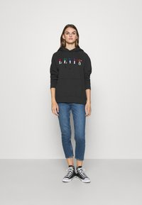 Levi's® - GRAPHIC SPORT HOODIE - Sweat à capuche - black - 1