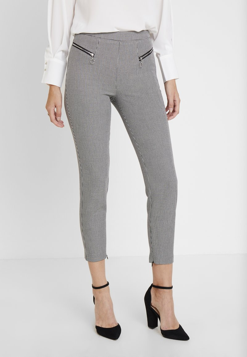Guess - CARRIE PANTS - Trousers - black/white