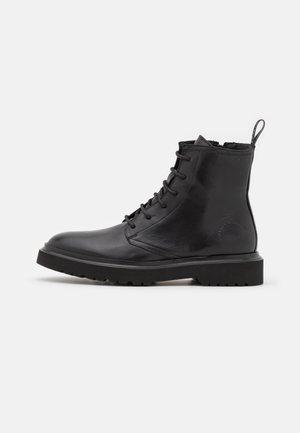 BRISBANE  - Lace-up ankle boots - black