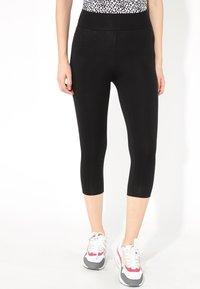 Tezenis - CAPRI - Leggings - Trousers - nero - 0