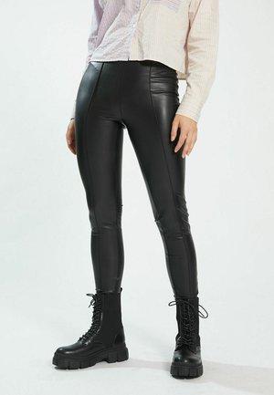 AUS - Leggings - Trousers - schwarz