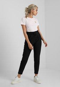 ONLY Petite - ONLPOPTRASH CLASSI PINSTRIPE FRILL - Trousers - black - 1