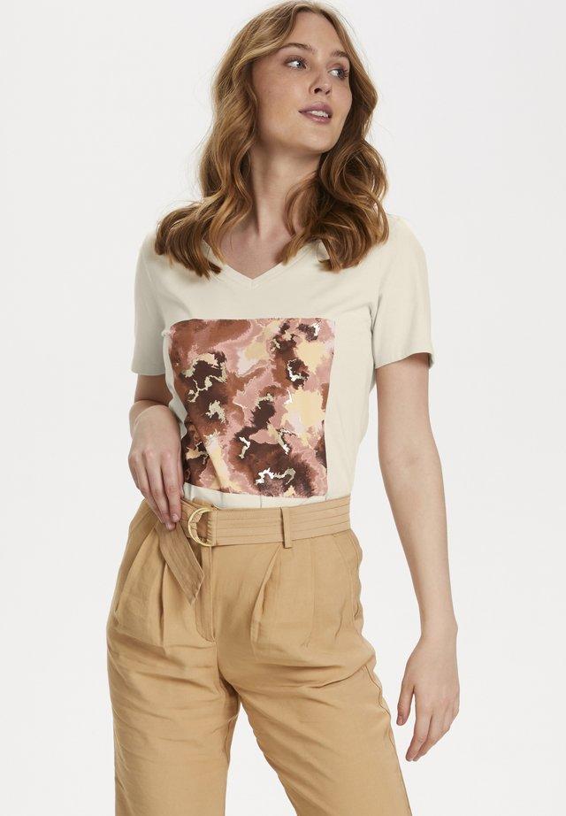 T-shirt con stampa - Creme