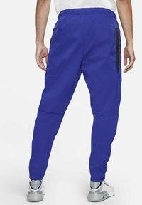 Nike Sportswear - Tracksuit bottoms - deep royal blue/black - 2