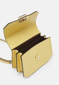 ALDO - FELLE - Across body bag - light yellow - 2