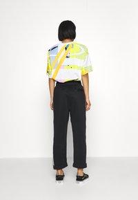 adidas Originals - BF ADICOLOR PRIMEBLUE RELAXED PANTS - Tracksuit bottoms - black - 3