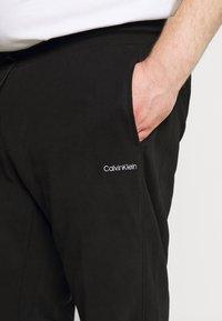 Calvin Klein - LOGO EMBROIDERY - Pantaloni sportivi - black - 4