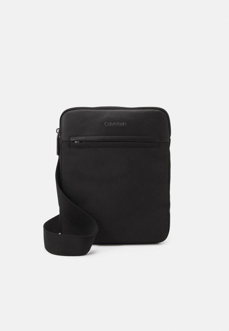 Calvin Klein - FLATPACK UNISEX - Across body bag - black