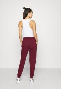 Nike Sportswear - PANT - Tracksuit bottoms - dark beetroot/metallic gold - 2