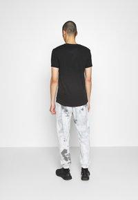 Nike Sportswear - Tracksuit bottoms - smoke grey/iron grey/white - 2