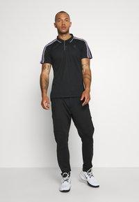 Björn Borg - TYLER - T-shirt sportiva - black beauty - 1