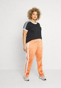 adidas Originals - ADIBREAK - Tracksuit bottoms - hazy copper - 1