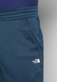 The North Face - MENS SURGENT CUFFED PANT - Teplákové kalhoty - blue wing teal heather - 4