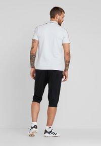 adidas Performance - CORE ELEVEN AEROREADY 3/4 SPORT PANTS - Träningsshorts 3/4-längd - black/white - 2